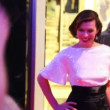 Milla Jovovich poses for photographers and journalists in shopping mall Vegas — Stock Video