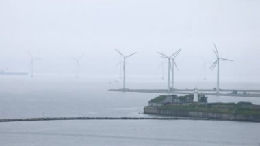 Ships pass between wind farms in gloomy weather, time lapse — Stock Video
