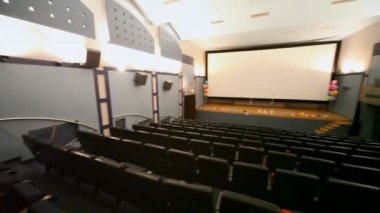 Panorama of small almost empty light cinema hall — Stock Video