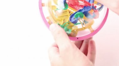 Hands rotate three-dimensional toy puzzle — Stock Video