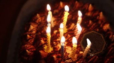 Happy Birthday cake with burning spiral candles in dark — Stock Video
