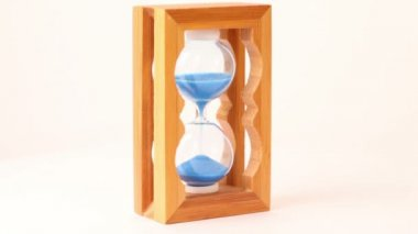 Hand take wooden framed hourglass — Stock Video