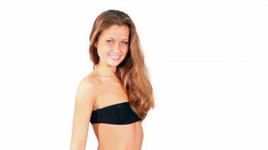 Model in black bra looks and smile — Stock Video