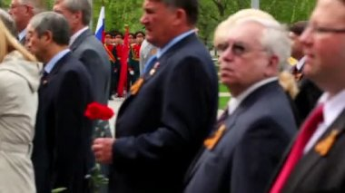 President Dmitriy Medvedev stand near military man, official establishment walk with flowers — Stock Video