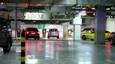 Several cars ride away from underground parking garage — Stock Video