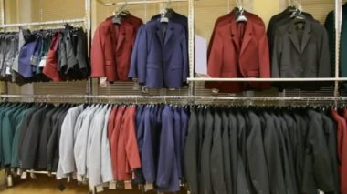 Panorama of jackets hanging in shop — Stock Video