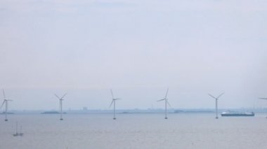 Wind farms stationed on water in front of Copenhagen, time lapse — Stock Video