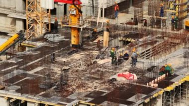 On floor of under construction building workers are engaged in building — Stock Video