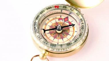Golden vintage compass rotates — Stock Video
