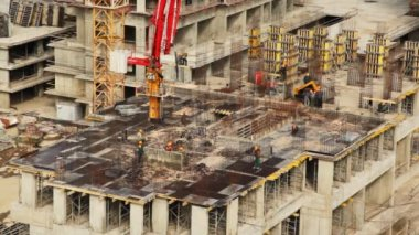 Workers with heavy machinery build one of house floors — Stock Video