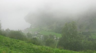 Little Norwegian village covered in fog — Stock Video