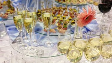Hand take glass of champagne from appetizer table with canape and other delights — Stock Video