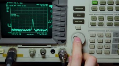 Hand push buttons and rotates knob on oscilloscope for old video repair — Stock Video