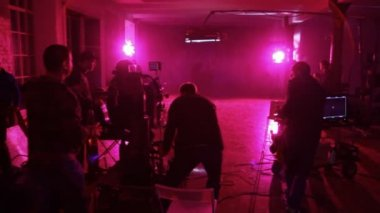Film crew moves videocamera and equipment on platform in shooting of Rene clip — Stock Video
