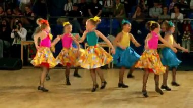 Several children in shoes with taps and colorful costumes tap dance — Stock Video