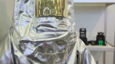 Protective suit for person from silvery material — Stock Video