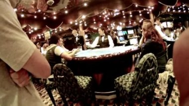 Work of croupier behind table in casino — Stockvideo