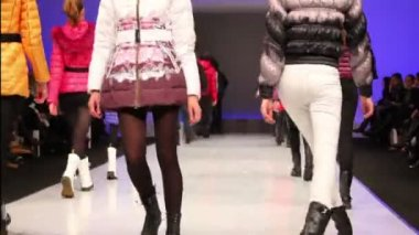 Young models walk away in winter clothes from Snowimage Collection — Vídeo de stock