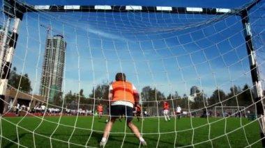 People play football at stadium — Stock Video