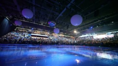 People wait for begining of ice show, when machine polishing ice — Stock Video