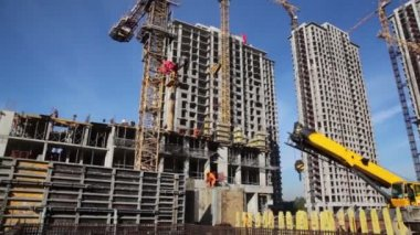 Tall buildings under construction and cranes — Stock Video