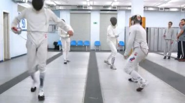 Four fencers train in sports hall of Dynamo club — Stock Video