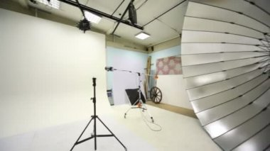 White background inside studio light room with lamps and spotlights — Stock Video