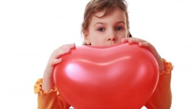 Little girl hold big heart shaped balloon and then she release it — Stock Video