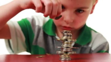 Boy makes highly complicated figure with coins on red base — Stock Video