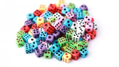 Many colorful dice stacked in pile rotate on white — Stock Video