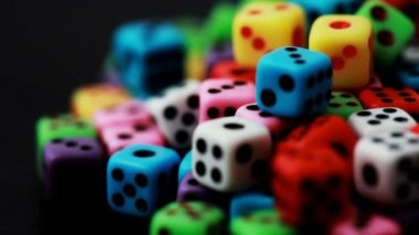 Many colorful dice stacked in pile rotate on black — Stock Video