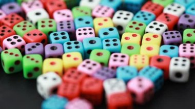 Many colorful dice rotate on black — Stock Video