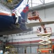 Flight mechanics spend checkup of plane Aeroflot in hangar Sheremetyevo airport — Stock Video