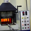 Stock Video: Flame burns inside annealing furnace, mcame and closes it