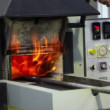 Stock Video: Mopens annealing furnace, flame goes outside