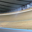 Bicyclists compete on bicycle track in sports complex — Stock Video