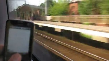 Orientation in locality looking through train window and using navigator — Stock Video