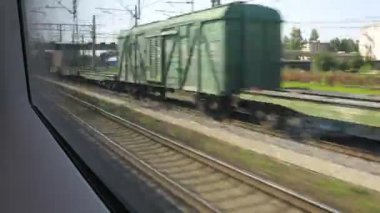 Rail tracks, view from window in train, time lapse — Stock Video