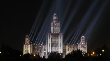 Moscow State University is shone at night by projectors — Stock Video