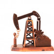 Souvenir oil pump spin clockwise about of axis on white background — Wideo stockowe