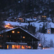 Windows of Central Spa Hotel are shone by evening light which is reflected from snow — Stock Video