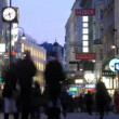 Stock Video: Tourists walk on Kartner Strasse across evening Vienna