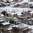 Roofs of houses stand covered with white snow — Vídeo de stock
