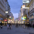 Stock Video: Tourists go on Kartner Strasse and on pedestricrossing