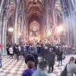 Stock Video: Tourists are photographed in church Stephansdom