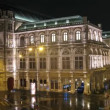 Building of Viennese opera stands shine in night city — Stock Video