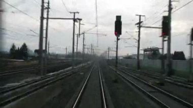 Train goes by rail near with inhabited locality along electric mains — Stock Video