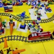 Stock Video: Toy train moves by railroad among different objects
