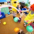 Stock Video: Big red clown girl plays with children in Moscow kindergarten 143