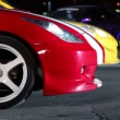 Several cars with colorful sport design, two vehicles start move — Stockvideo